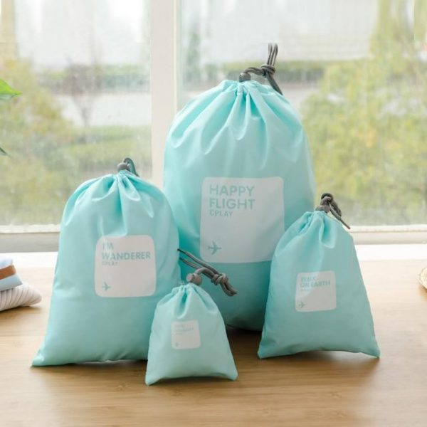 This is an image of a 4 piece set of happy flight drawstring bags