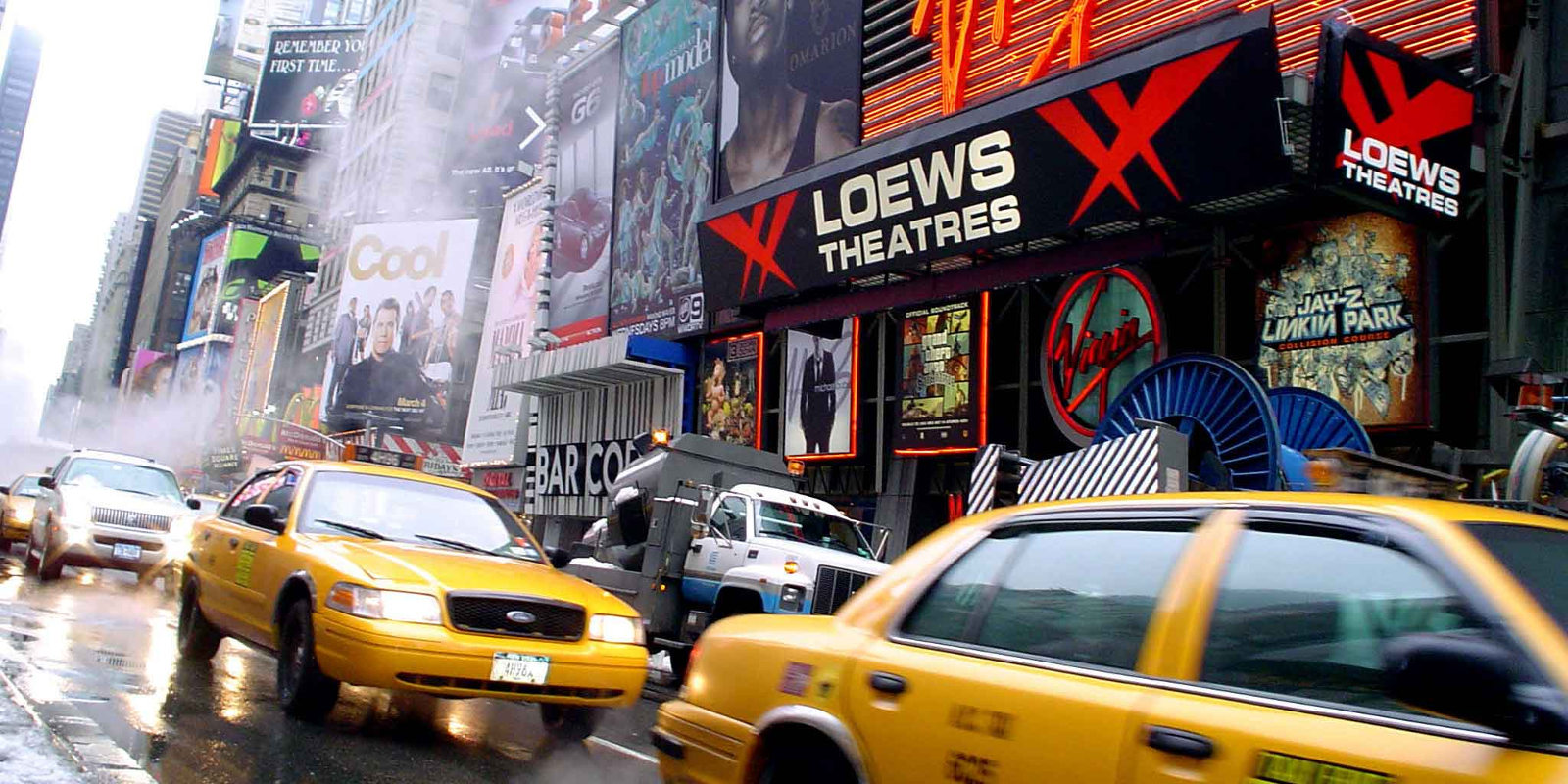 This is an image of traffic in front of Loews Theatres Cineplex Time Square